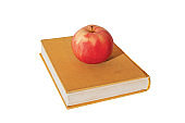 Apple on book, one of the symbols of school, education, study, knowledge, learning and teaching.