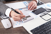 Businessman using calculator for analysis marketing plan. Business, Accounting