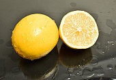 Lemon. Fruit with half and leaves