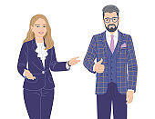 Friendly woman and man in elegant clothes