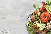 Flat composition with fresh food on gray table, place for text. Healthy eating