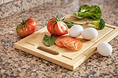 Fresh products lie cutting board for making breakfast