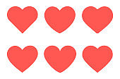 Set of red hearts flat icons.