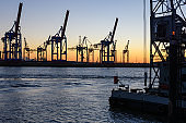 Hamburg, Germany: Shipyard cranes at the docks in the port  in the twilight