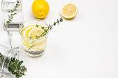 Lemon drink in glass. Thyme sprigs in glass.