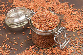 Brown rice in glass jar.