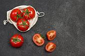 Tomatoes in  reusable mesh bag.
