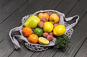 Lychee, pear, apples and lemon in reusable mesh bag