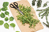 Microgreen pea sprouts and scissors on brown paper.