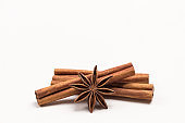 Star anise spices and cinnamon sticks close up.