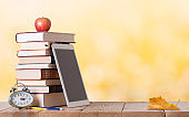 Education background with books in the autumn