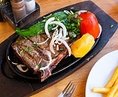 Delicious grilled beef steak with potatoes and vegetables