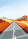 Autumn road stretching into the horizon.