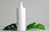 White plastic cosmetics container for cream or shampoo.