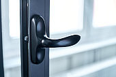 close-up. chrome handle on the window frame