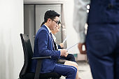 young asian job applicant waiting for interview