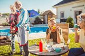 Senior women relaxing while having backyard barbecue party