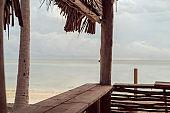 Tropical beach bar counter in sunrise