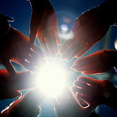 close up. young business people joining their palms in a circle