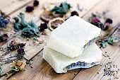 Natural handmade lavender soap on a wooden background with dried flowers. Cosmetics for spa, relaxation