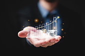 hand of businessman with graph of business growth concept, graphic of global network marketing finance chart, investment or exchange stock, display of success information trade rate statistic diagram