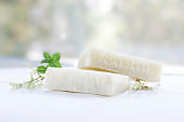 Natural bath soap with herbs on a white background.