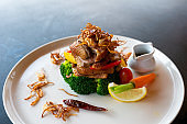 Roasted duck with seasoning sauce and vegetable on plate