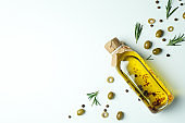 Bottle of olive oil, olives and spices on white background
