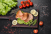 Delicious juicy tuna steak grilled with spices and herbs