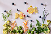 sea world, creative meal, image from fruit and vegetables in yellow and green colors, isolated