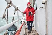 Fisherman walking through the boat while preparing to fishing