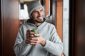 Man smiling and drinking coffee in the morning at the boat