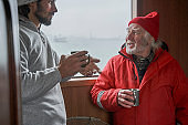 Fishermans discussing work inside of the boat
