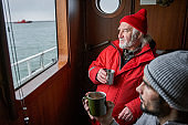 Fisherman drinking tea with his colleague at the boat