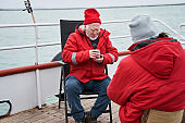 Fishermans discussing work at the boat while drinking tea