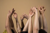 Women posing at the studio with raised hands
