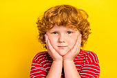 Photo of young adorable happy small boy hold hands cheeks good mood smile isolated on yellow color background