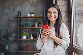 Photo of charming attractive happy positive cheerful smiling good mood woman in glasses using smartphone at home house