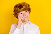 Portrait of young handsome serious ponder thoughtful schoolboy look copyspace brainstorming isolated on yellow color background