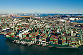 Huge intermodal cargo ship at Long Beach Port in California USA