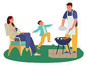 Family Having Barbeque Party Outdoors.
