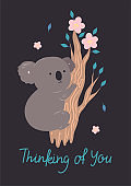 Postcard with a cute koala on a branch. Vector graphics.