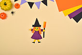 Craft for children made of paper. A Homemade Witch. Do it yourself.