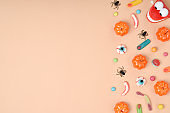 Halloween treats on an orange background. Various candies with a place for text.
