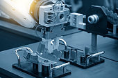 The hi-technology  material handling process by robotic system with sheet metal parts.