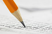 Accounting document with pencil, and checking financial chart. Concept of banking, financial report and financial audit.