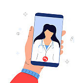The patient makes a video call to the doctor online. Hands holding smartphone. Telemedicine concept. Medical worker advises a sick person remotely