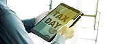 man and tablet with text tax day, web banner