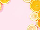 Colorful orange citrus slice fruit texture background on pastel pink