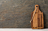 Cutting board on wooden kitchen table